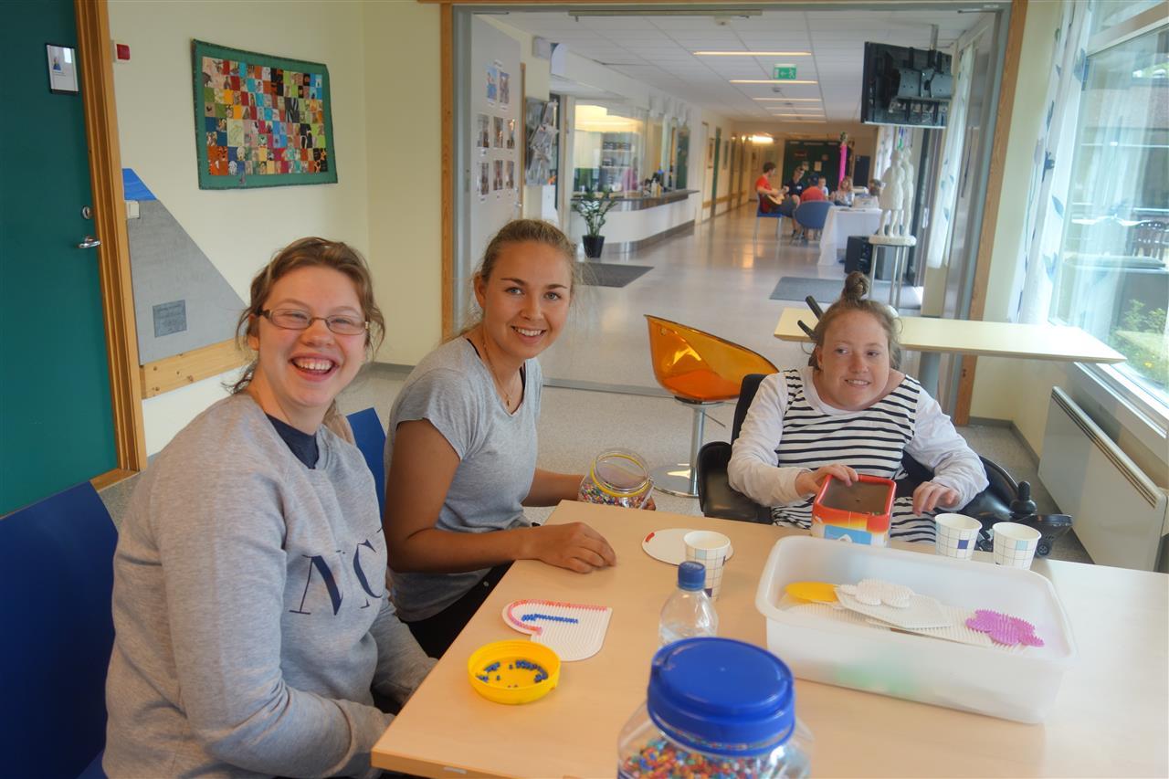 Tre glade deltakere